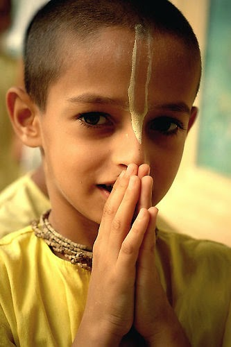 Vaishnava tilaka on a kid - spiritual markings on the forehead